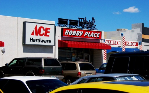 Ace's Hobby Place, next to the Barber Shop.