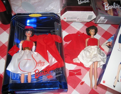 Silken Flame Barbie and vintage counterpart.
