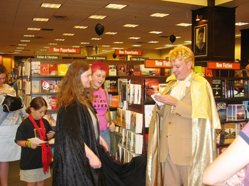 Gilderoy Lockhart greets his public, including a fan of the Weird Sisters.