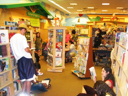 Adults crowd the kids' section without shame.