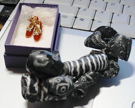 my purchases: ruby slippers and melted beads.